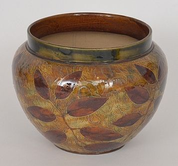 A late 19th Century Royal Doulton jardiniere decorated in the Autumn Leaves…