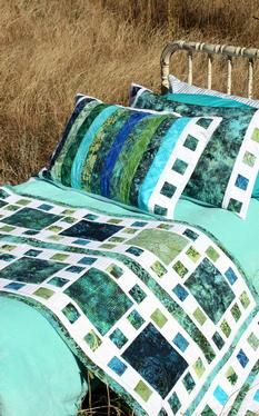 Mosaique de Mer Pattern Download for a bed runner and pillowcases. Could make a great full sized quilt too. Beautiful in blue and green batiks