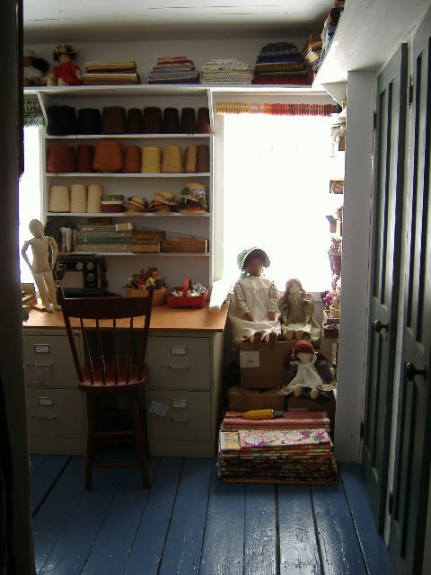 The workroom: the doors to the right are a storage closet and a small bath.