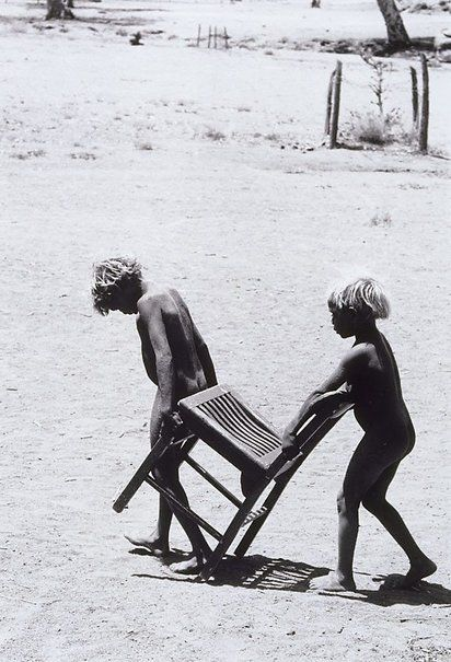 Pitjantjatjara children with chair, South Australia by David Moore 1963
