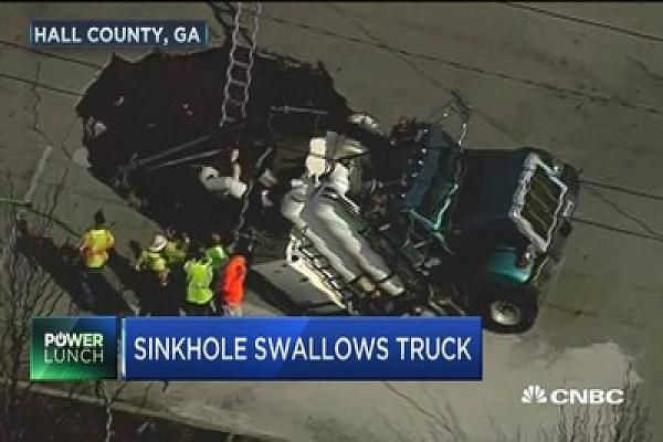 A huge sinkhole in Hall County, Georgia swallows a semi-truck.  (VIDEO)