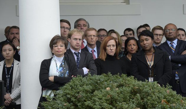 Staff listen as President Barack Obama speaks about the election results, Wednesday, Nov. 9, 2016, in the Rose Garden at the White House in Washington. Senior Adviser Valerie Jarrett, third from left, White House Communications Director Jen Psaki, center, and National Security Adviser Susan Rice, seventh from right, listen.(AP Photo/Susan Walsh)