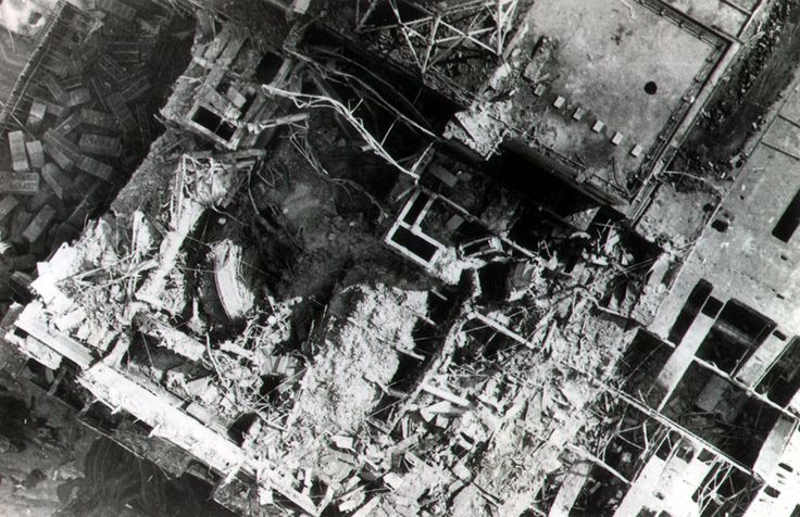 rbmk_chornobyl_341 - Looking into the debris-filled reactor (look for the inverted lid on the left). The 1000-ton lid is now wedged 4 feet lower than it rested before the explosion.  Taken from GlobalSecurity.org