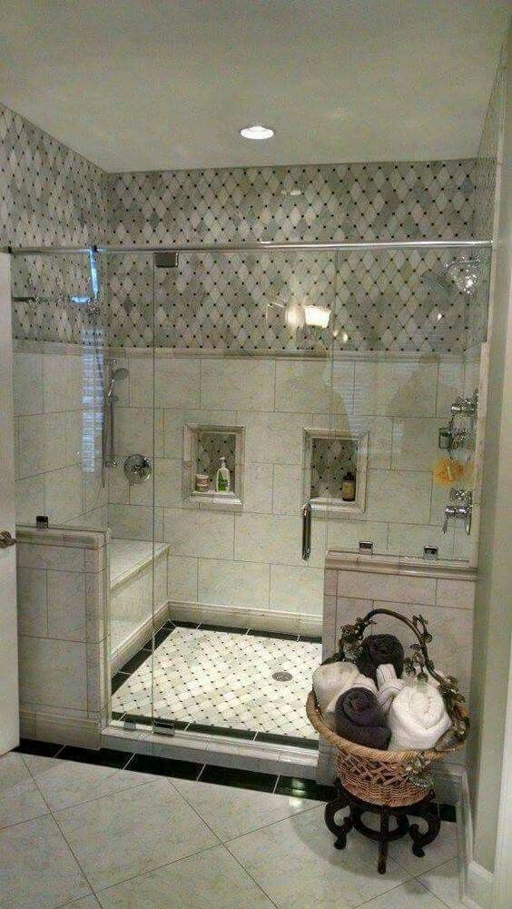 Beautiful shower with Carrara Marble tile wall