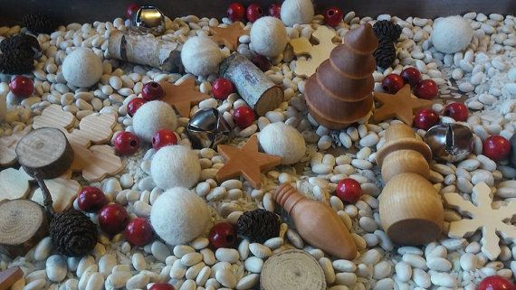 Holiday Sensory Mix!  This set has an eclectic mix of natural materials for little hands to explore in Sensory Bins as they build language, imagine, play learn and grow!  Each Set includes: 10 White wool balls, 2 wooden snow men and 5 holiday lights, 8 snowflakes, 2 pine trees, 8