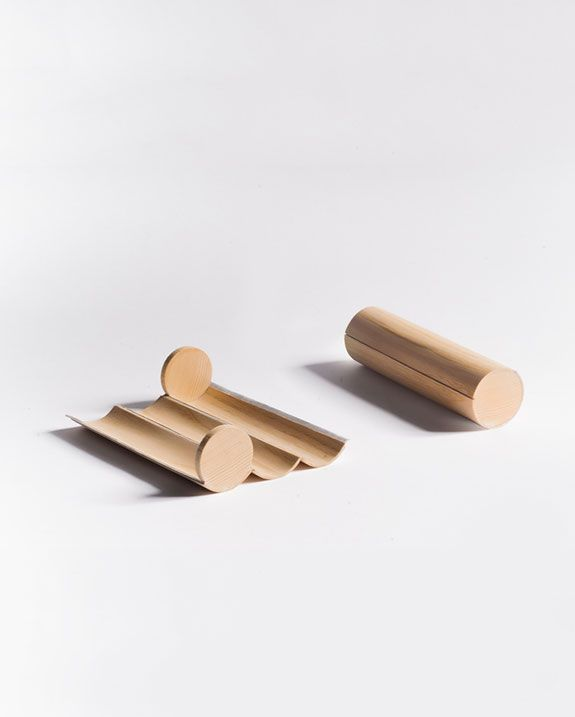 Malafej's three tabletop objects – lamp, wooden pencil case (the last developed with Rosenthal) – explore sculptural, minimal shapes adapted to diverse functions. www.etcetc-studio.com