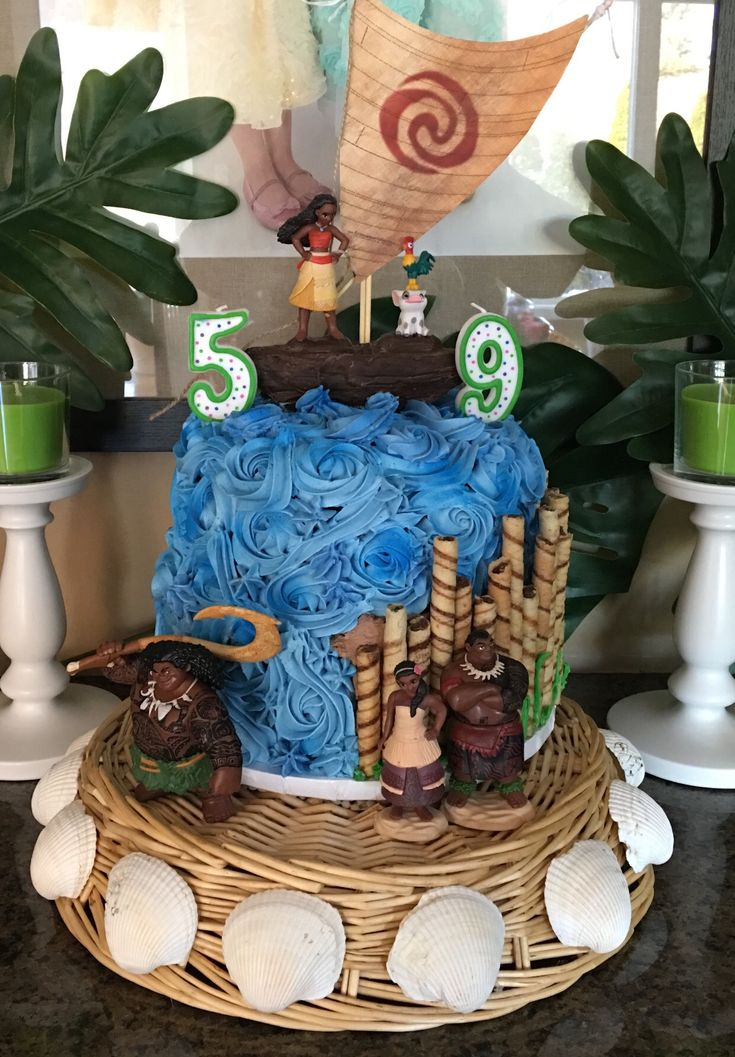 Moana Birthday Cake with Ocean, Boat, and Pirouette Cookie Bamboo.