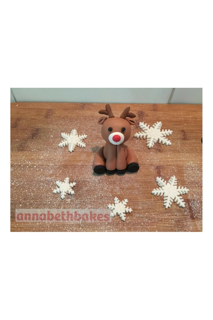 Fondant cake topper - Rudolf surrounded by snowflakes ready for Christmas