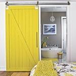 I love the barn door feel to this.: The Doors, Bathroom Doors, Sliding Barns Doors, Barn Doors, Interiors Barns Doors, Masterbath, Master Bath, Yellow Doors, Sliding Doors