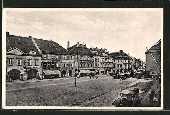 old postcard: AK Komotau / Chomutov, der Marktplatz, Ladengeschäfte Josef Konirsch, Franz Watzeu