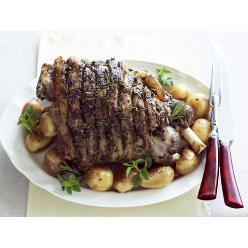 This authentic slow cooked Greek style roast lamb recipe can be done in the slow cooker or oven. Serve with potatoes for a family dinner recipe.