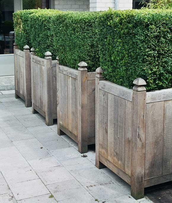 Out-Standing is a woodworking shop that produces handmade planters, outdoor tables, garden gates, lamps, and finials, mostly using rustic oak. They regularly exhibit at the Maison & Objet in Paris; go to Out-Standing to view the full line.  In the US, the planters are available through March in SF and Emily Joubert in Woodside, CA.