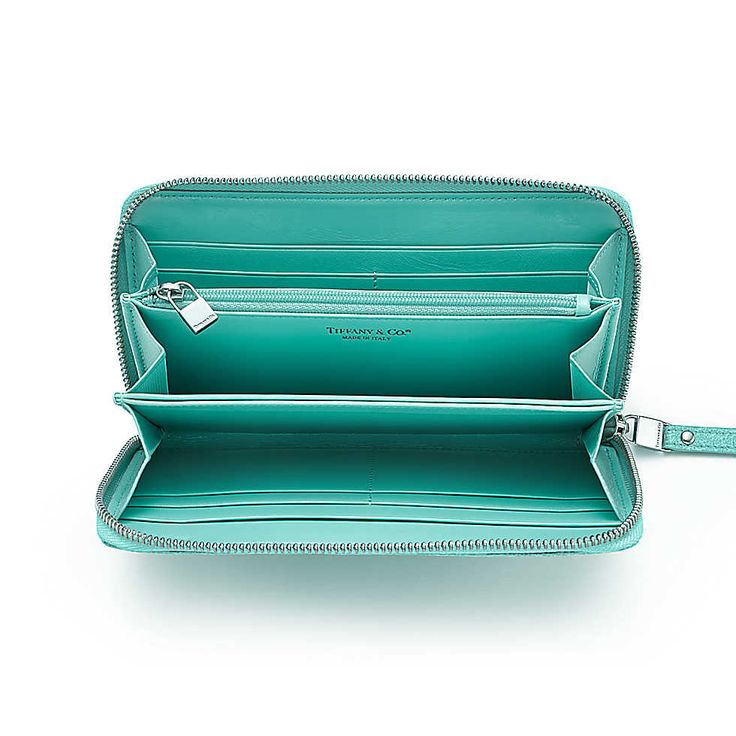 Zip continental wallet in Tiffany Blue textured leather. More colors available.