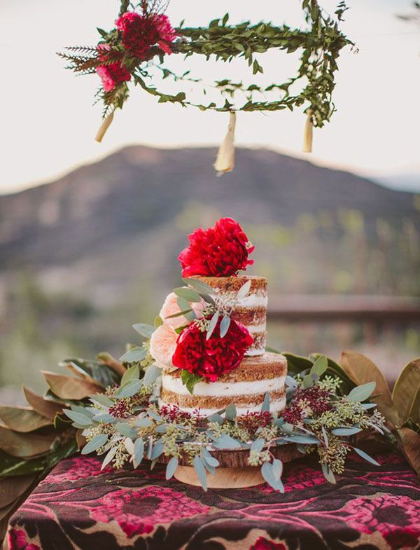 naked cake with red flowers and foliage
