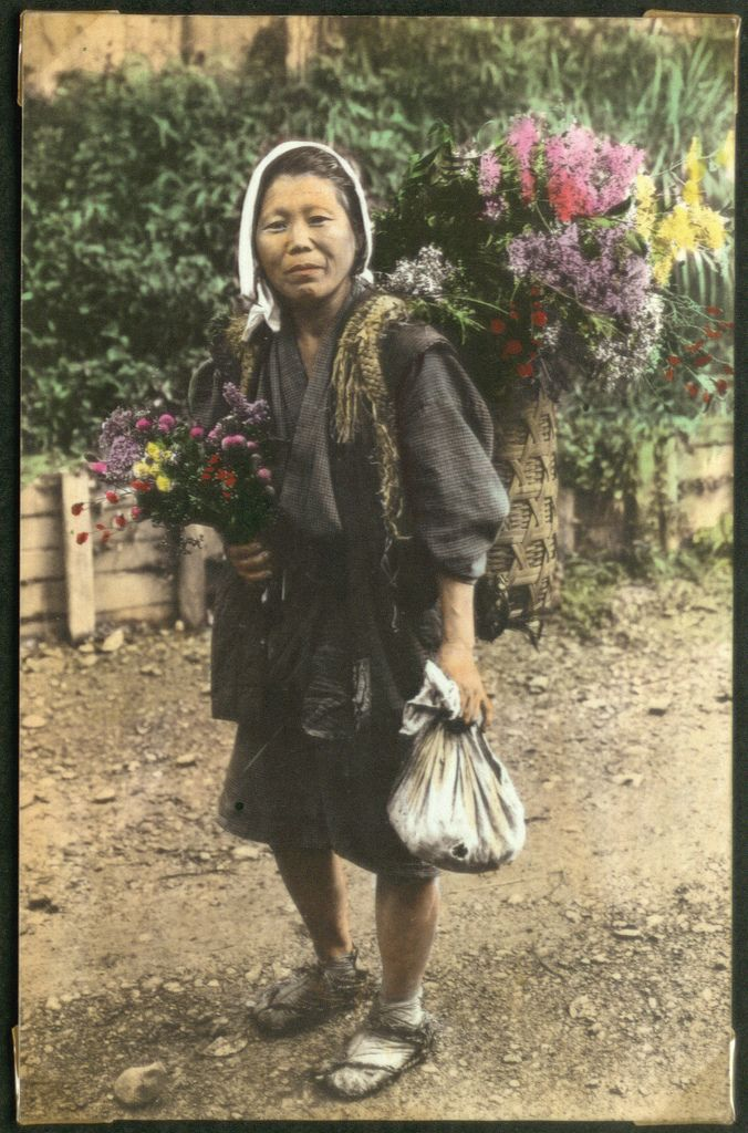 Woman with flowers in a basket on her back
