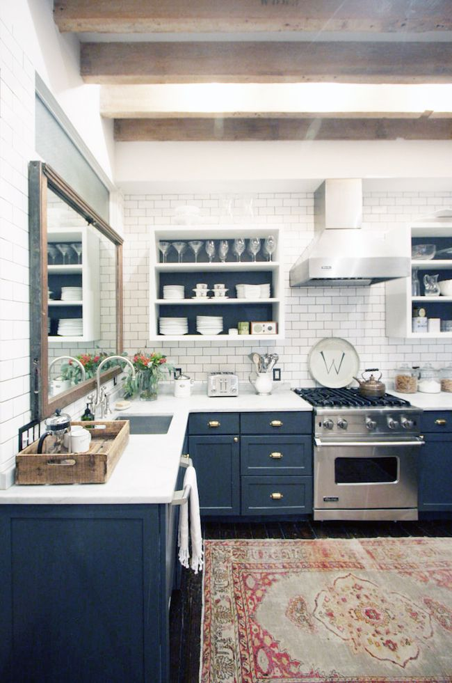 Navy blue kitchen cabinets with a vintage rug