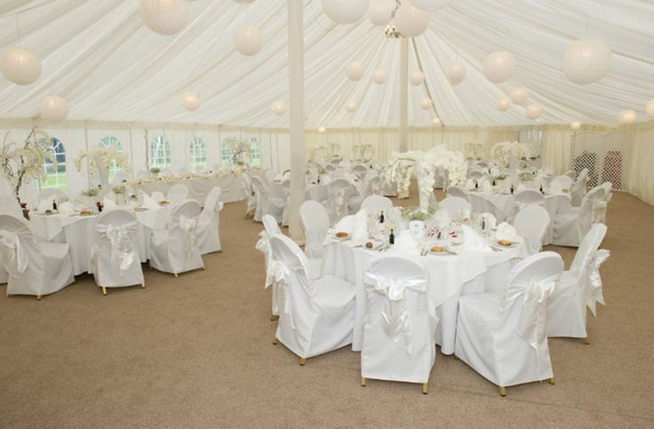 A white-themed marquee at Prested Hall http://www.prested.co.uk/weddings/