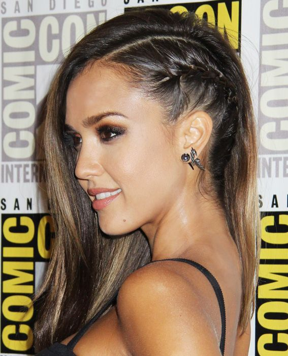 """To achieve Alba's sexy side plait, hairstylist Renato Campora parted the star's wet strands from the top of her head down to the nape of her neck. After spritzing gel on the left side, he created a corn row braid from the front to the back. """"I made sure the braid ended underneath the loose hair from the right side,"""" he tells us. He secured with a small rubber band to finish."""