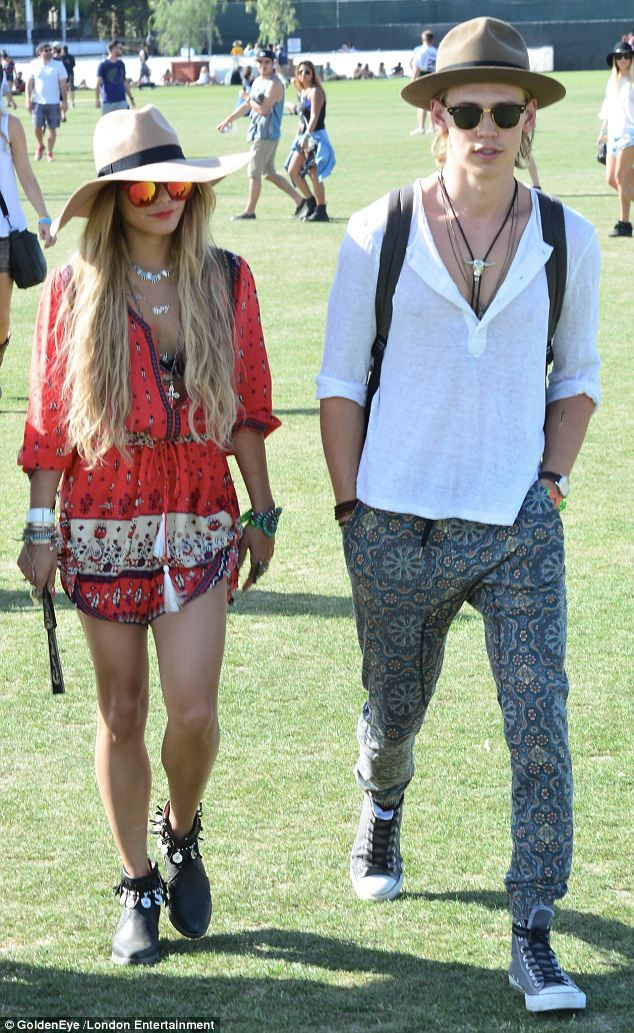 Festival spirit: The couple chose appropriate retro-themed outfits for their day out...