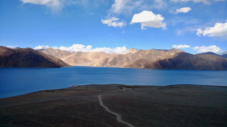 """Pangong Tso, Tibetan for """"high grassland lake"""", also referred to as Pangong Lake, is an endorheic lake in the Himalayas situated at a height of about 4,350 m. It is 134 km long and extends from India to China."""