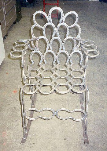 Rocking chair made outta horse shoes.. Really Cool!