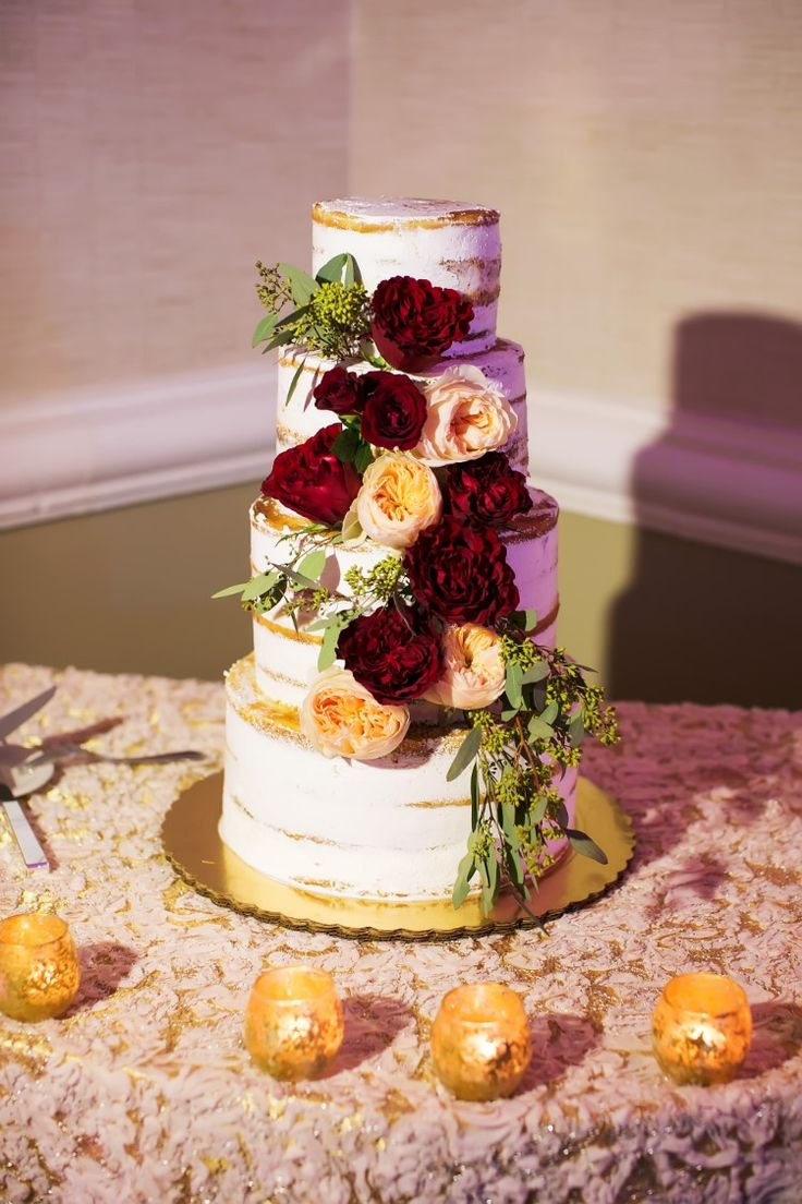 Gorgeous naked wedding cake with marsala and peach flowers (Limelight Photography)