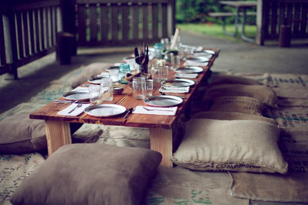 Low table with diy burlap/coffee-sack cushions. Perfect for a rooftop or outdoor casual dinner, or even a picnic.