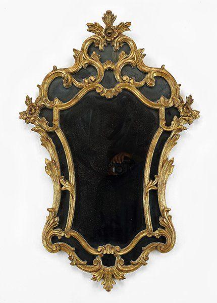 An italian baroque style mirror lot 1641146 mirror for Italian baroque mirror