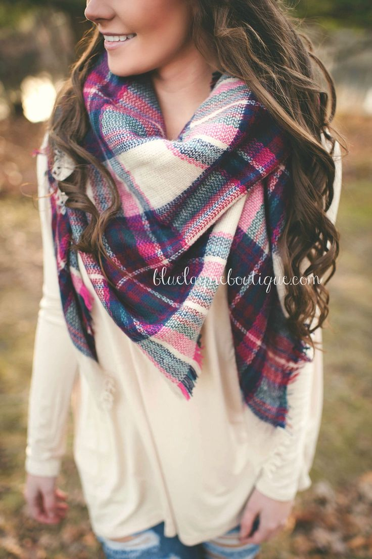 Love the scarf and longer sweater under it.