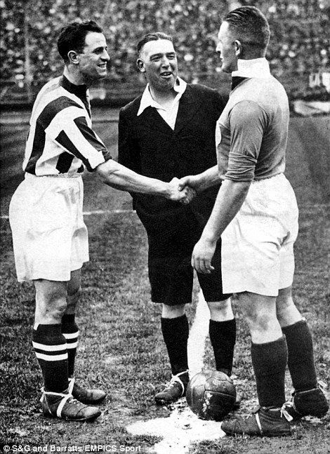 A picture from the 1931 FA Cup final between West Bromwich Albion and Birmingham, with Baggies captain Tommy Glidden and Blues skipper Ned Barkas shaking hands under the watchful eye of referee Arthur Kingscott