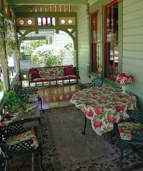 Pretty Porch On A Green Victorian Guesthouse With Red Trim