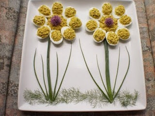Nice way to serve deviled eggs- grass is dill and stems are chives :)