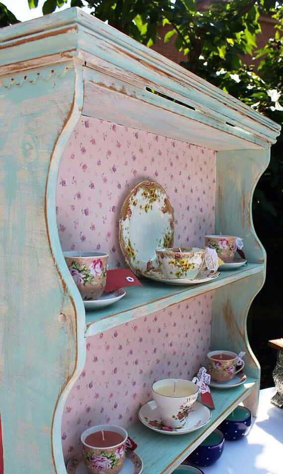 Cute shabby shelf w/tea cup candles.  Shabby Chic Shelving Unit by AnotherMansTreasure9 on Etsy, £45.00.
