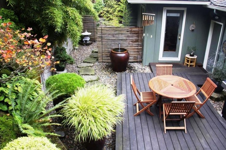 Simple Oak Chairs And Round Table On Natural Deck For Small Garden Ideas With Stone Pathway