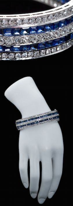 https://www.bkgjewelry.com/emerald-rings/553-18k-white-gold-diamond-emerald-ring.html Identical Pair of Art Deco Sapphire Diamond Bangles, A pair of Art deco bangles with Old European cut diamonds and square step cut sapphires as a alternating traight line design. Contains approximately 40cts diamonds and 30cts of sapphires. USA Art Deco.