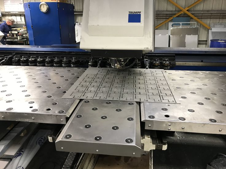 CNC punching a sheet metal guide plate at V and F Sheet Metal, Hampshire. http://www.vandf.co.uk/blog/manufacturing-a-sheet-metal-stainless-steel-guide-plate-with-tapped-holes/