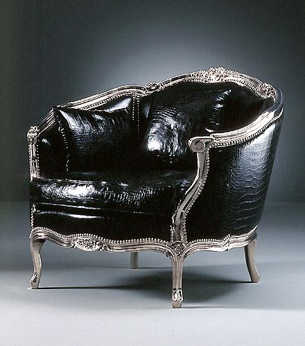 Carved Armchair upholstered crocodile leather with structure in solid carved wood and chromed finish. The armchair is upholstered here in black crocodile.