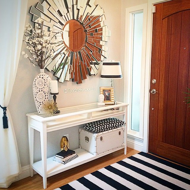Styled her entryway with our dazzling empire mirror