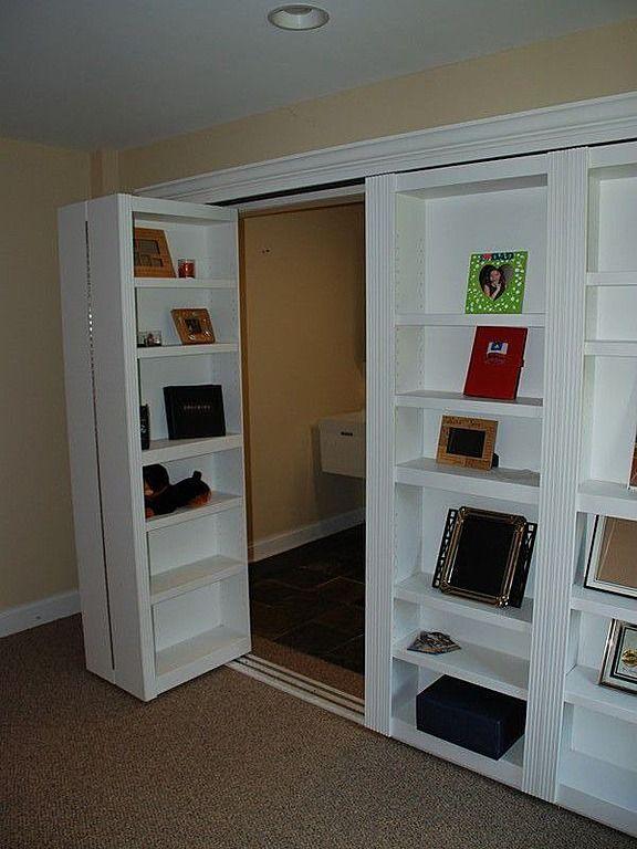 Hidden room behind bookshelves For the basement into workroom