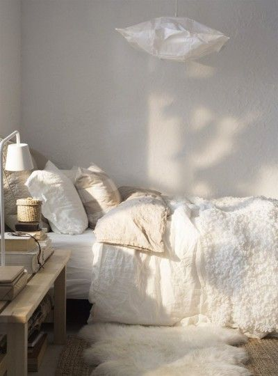 White on white bedding ~ mixture of luxurious textures
