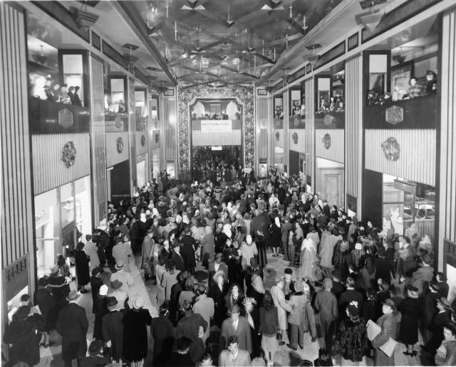 What Is the History of Black Friday?: Shoppers listening to the Mabley Christmas Carolers in the arcade of the Mabley & Carew Department Store, Cincinnati, Ohio, 1950s