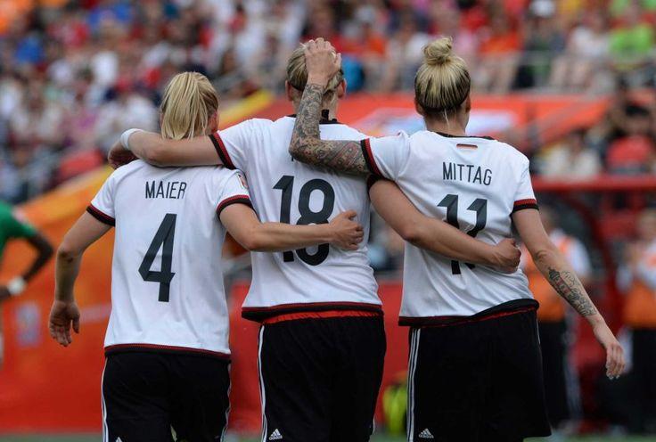 Germany's Leonie Maier, Alexandra Popp and Anja Mittag...