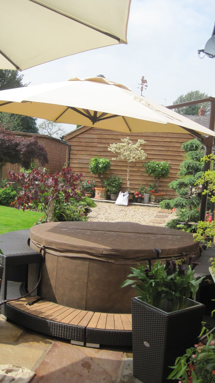 softub patio under umbrella outdoor. Black Bedroom Furniture Sets. Home Design Ideas