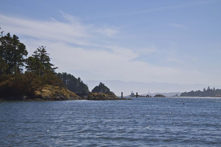 Fisgard Lighthouse from beach in Portage Park, Victoria BC Photo