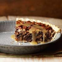 1/2 cupbutter  3/4 cuplight-color corn syrup  2/3 cupgranulated sugar  2/3 cuppacked brown sugar  2 tablespoonswater  1/4 teaspoonsalt  1 cupwhipping cream  2 teaspoonsvanilla  2 1/2 cupspecan halves  Pastry for a Single-Crust Pie  3 eggs, lightly beaten  6 ouncesdark, bittersweet, or semisweet chocolate, chopped  Whipped cream (optional)