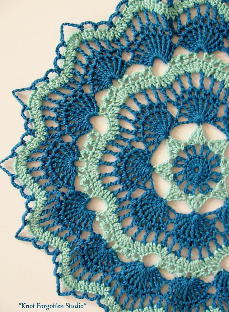 White Fan Doily~  Aunt Lydia's size 10 thread in Aqua and Blue Hawaii. The pattern is by Beth Mueller.