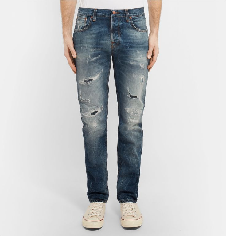 <a href='http://www.mrporter.com/mens/Designers/Nudie_Jeans'>Nudie Jeans</a>' 'Grim Tim' jeans have been crafted in Italy from organic cotton-denim. Hand-distressed and heavily faded for a rugged, lived-in look, they are accented with marigold stitching and copper trims. Make them the foundation of your laid-back weekend wardrobe.