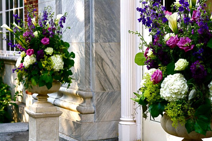 Altar arrangements - hydrangea, delphinium, calla lilies, roses and stock in white, lavender and purples