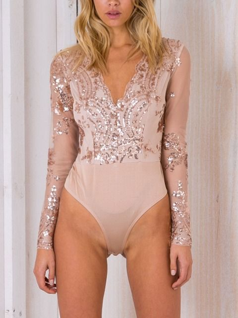 Champagne long sleeve bodysuit, shimmering floral embellishment on the bodice and sleeves.