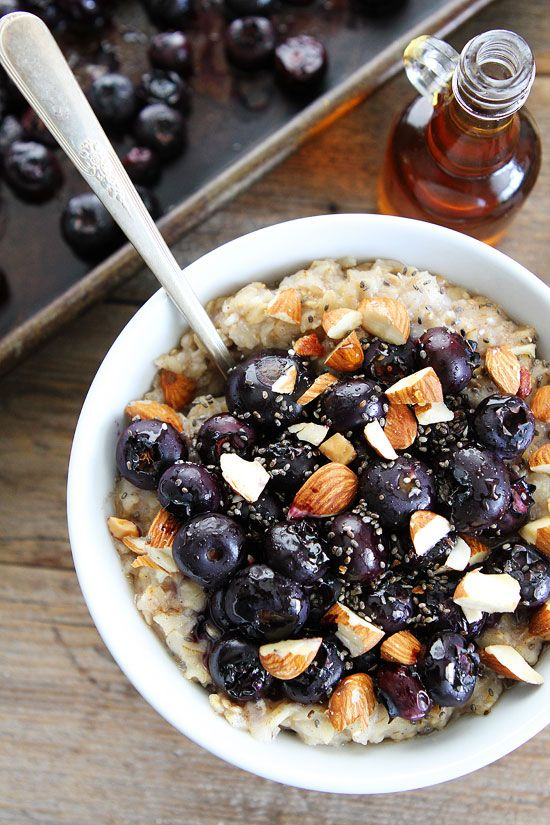 Maple Roasted Blueberry Almond Oatmeal Recipe on twopeasandtheirpod.com Hearty oatmeal topped with maple roasted blueberries, almonds, and chia seeds. This healthy bowl of oatmeal is SO good!